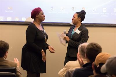 Stephanie Terry, left, owner of Sweeties Southern & Vegan Catering, and Latoyia Boria, Self-Help Area Manager, speak at our annual meeting
