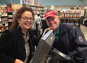 Smiles from a cashier and a long-time co-op member at Hendersonville Co-op.