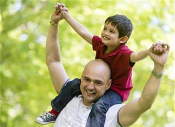 Latino Father with Child