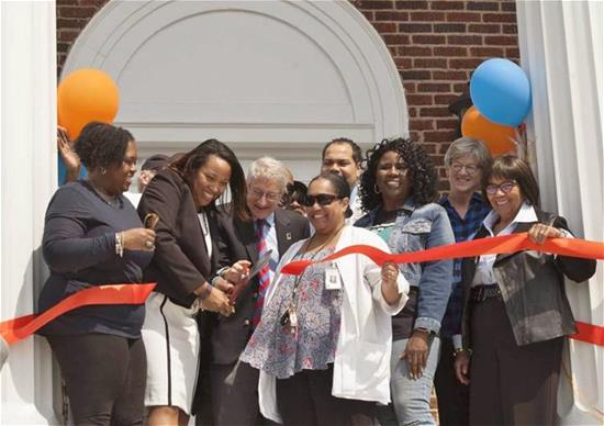 Cutting ribbon at grand opening of the ABC Center in East Durham, NC