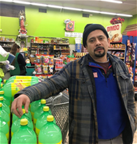 Homero Pina, grocer on the South Side of Chicago