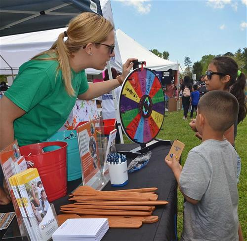 Self-Help's Samantha Pratt represents Self-Help at the recent International Children's Festival in Hendersonville.