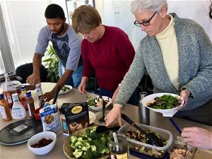Self-Help staffers at pot luck salad bar