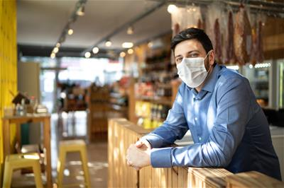 Small business owner wearing COVID mask