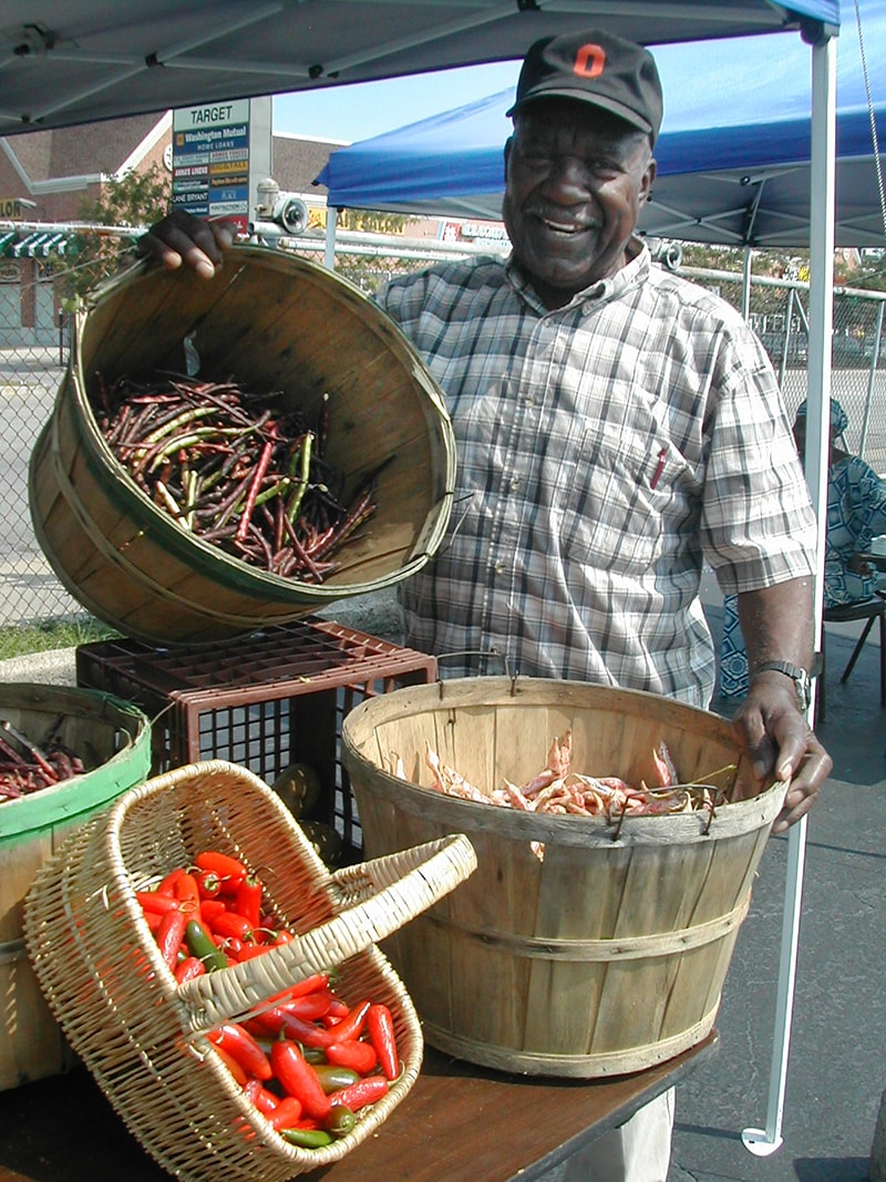 A seller with his wares at a farmers market in Chicago.